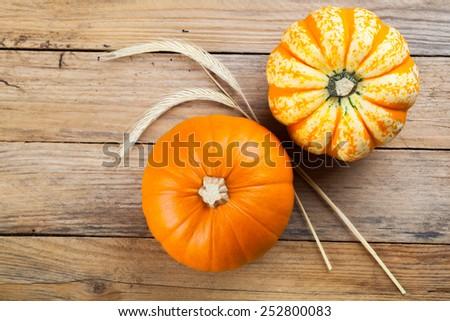 Autumn pumpkins on wooden board - stock photo