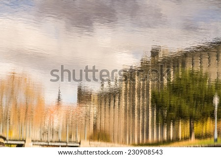 Autumn reflection on lake water from Montreal Canada downtown - stock photo