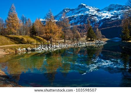 Autumn reflections on the lake Silvaplana - stock photo