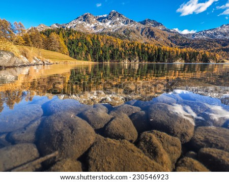 Autumn reflections on the lake Silvaplana, Engadine Saint Moritz, Switzerland - stock photo