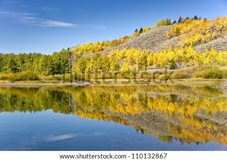 Autumn Reflections on Wyoming's Snake River - stock photo