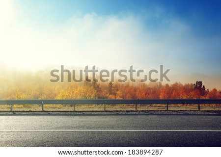 autumn road in sunset time - stock photo