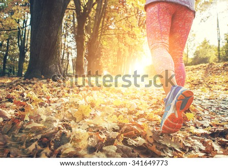 Autumn runner legs close up image - stock photo