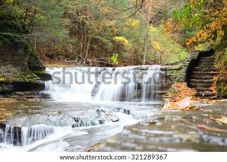 Autumn scene landscape of waterfalls at Robert H. Treman State Park - stock photo