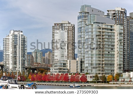 Autumn scene with orange trees and modern buildings in Yaletown, Vancouver, British Columbia, Canada - stock photo