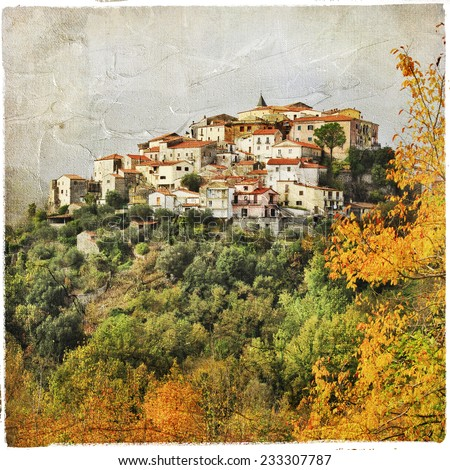 autumn scenery with hill top village in Italy, artistic picture - stock photo