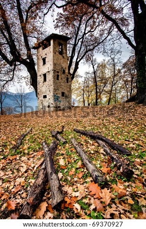 autumn scenery with old tower - stock photo