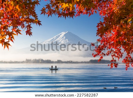 Autumn Season and Mountain Fuji with morning fog and red leaves at lake Kawaguchiko, Japan  - stock photo