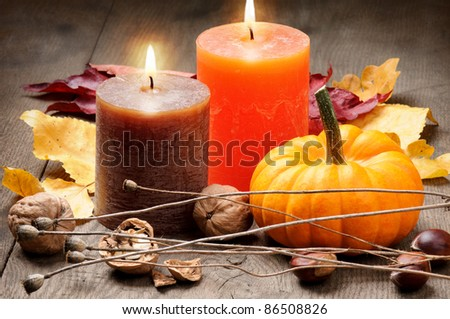 Autumn setting with candles and pumpkin - stock photo