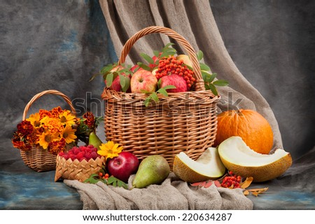 Autumn still life. Flowers and fruit on the table - stock photo