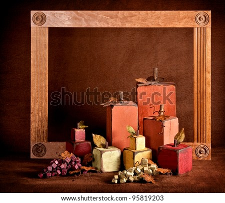 Autumn still life in squares with a frame and brown textured background. - stock photo