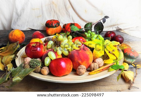 Autumn still life with fruits, nuts and leaves - stock photo