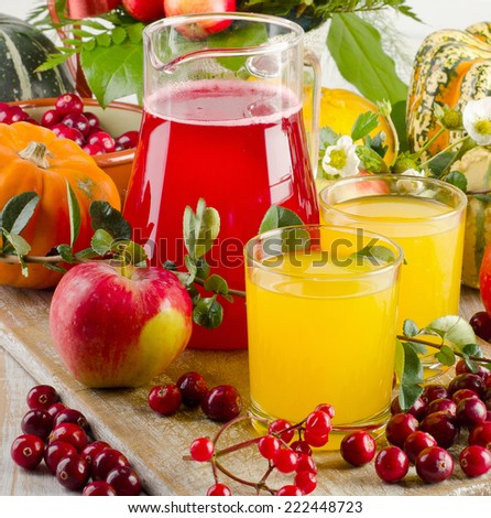 Autumn still life with juice, fruit and berries. Selective focus - stock photo