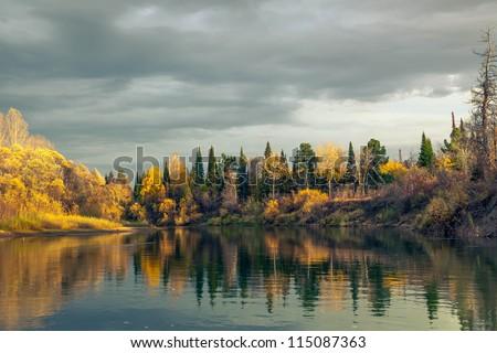 Autumn Sunset in the wild Siberian taiga - stock photo