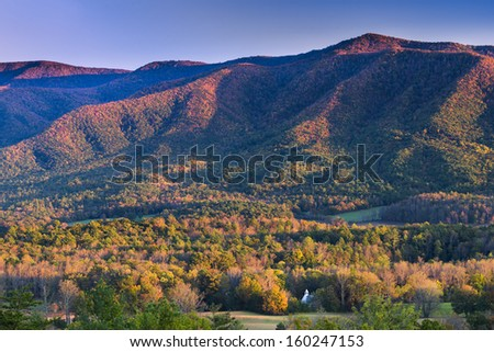 Autumn sunset view of Cade's Cove in Great Smoky Mountains National Park - stock photo