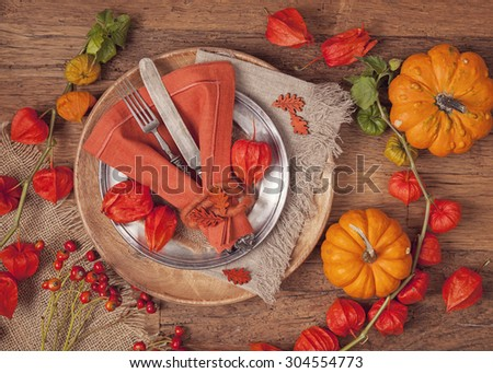 Autumn table setting with knife and fork - stock photo