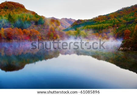 Autumn view of lake and mountain reflections in wedge pond, - stock photo