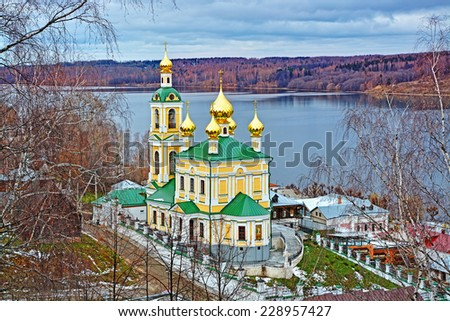 Autumn view of Volga river and orthodox church in old town Ples, Russia. - stock photo