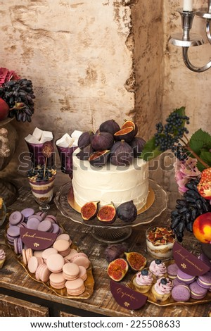 Autumn wedding sweet bar. Cake, cupcakes, sweetness and flowers. - stock photo