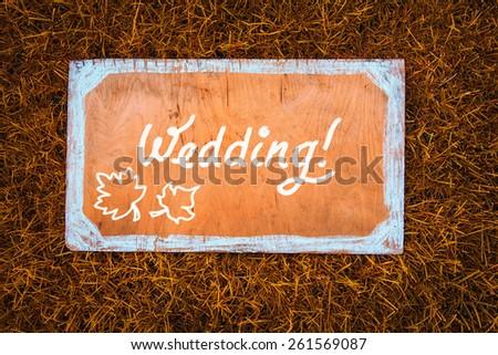 Autumn wedding wooden sign on the grass. - stock photo