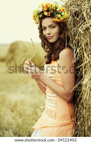 autumn woman close-up portrait with nature on the background - stock photo