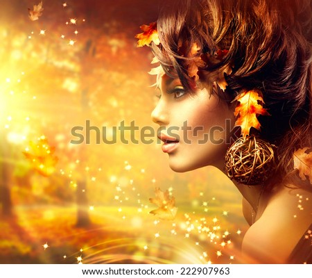 Autumn Woman Fantasy Fashion Golden Portrait. Fall. Beautiful Girl. Fashion Art Border Design. Hairstyle decorated with Autumn leaves.  - stock photo