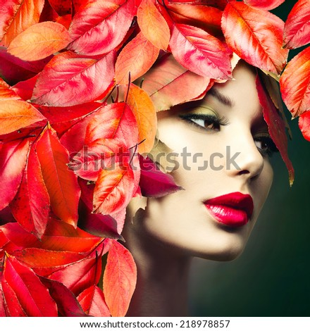 Autumn Woman Fashion Portrait. Fall. Beautiful Model Girl with colourful autumn leaves hairstyle. Red Autumn leaves Hair. Fashion Art design - stock photo