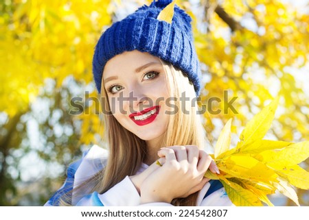 Autumn woman happy with colorful fall leaves - stock photo