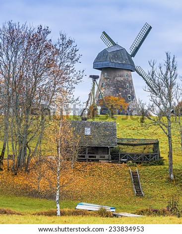 Autumnal landscape with medieval windmill, Latvia, Europe - stock photo