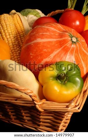 Autumnal vegetables, isolated on black background - stock photo