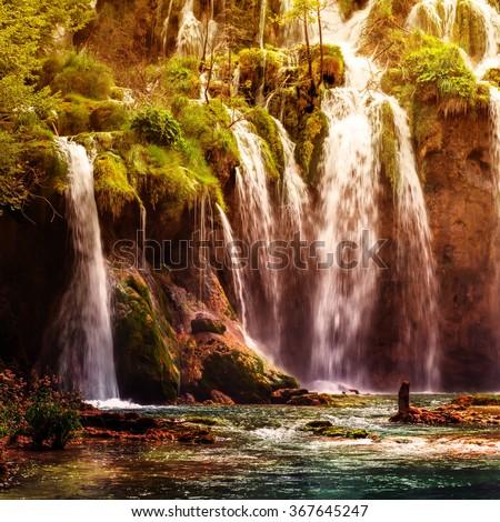 Autumnal view of beautiful waterfalls in Plitvice Lakes National Park, Croatia - stock photo