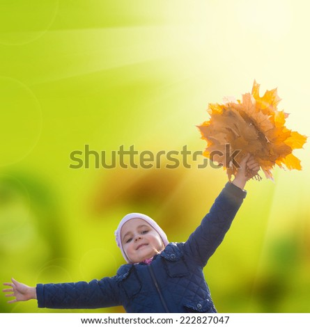 Autumntime.Girl with yellow autumn leaves - stock photo