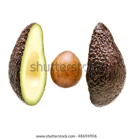 avacado sliced on white background with stone in centre - stock photo