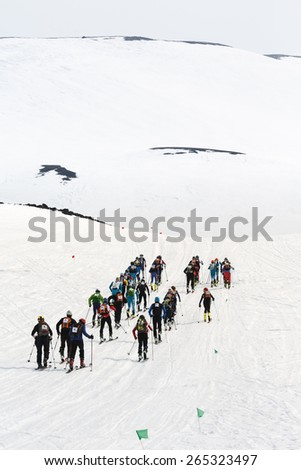 AVACHA, KORYAK VOLCANOES, KAMCHATKA, RUSSIA - APRIL 27, 2014: Group ski mountaineers climb on skis on Avacha Volcano. Team Race ski mountaineering Asian, ISMF, Russian, Kamchatka Championship. - stock photo