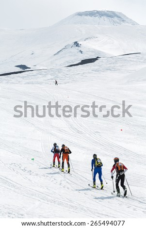 AVACHA, KORYAK VOLCANOES, KAMCHATKA, RUSSIA - APRIL 27, 2014: Teams of ski mountaineers climb the Avacha Volcano on skis. Team Race ski mountaineering Asian, ISMF, Russian, Kamchatka Championship. - stock photo