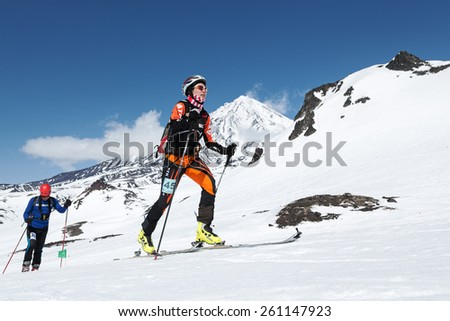 AVACHA VOLCANO, KAMCHATKA, RUSSIA - APRIL 26, 2014: Chinese ski mountaineer Ma Nan climbs on skis on volcano. Individual race ski mountaineering Asian, ISMF, Russian and Kamchatka Championship. - stock photo