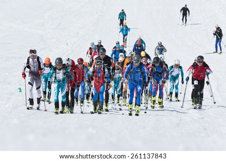 AVACHA VOLCANO, KAMCHATKA, RUSSIA - APRIL 26, 2014: Group of ski mountaineers climb to mountain on skis. Individual race ski mountaineering Asian, ISMF, Russian and Kamchatka Championship. - stock photo