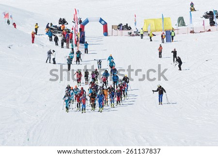 AVACHA VOLCANO, KAMCHATKA, RUSSIA - APRIL 26, 2014: Mass start race, ski mountaineers climb to mountain on skis. Individual race ski mountaineering Asian, ISMF, Russian and Kamchatka Championship. - stock photo