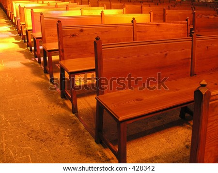 Available light shot of pews - stock photo