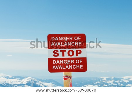 Avalanche sign and mountains at the background - stock photo
