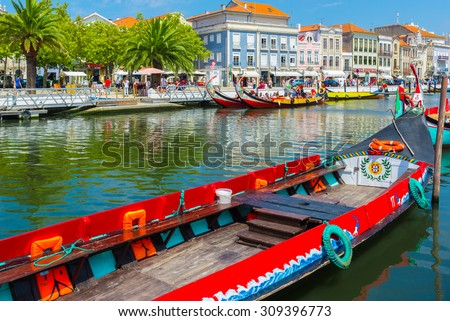 AVEIRO, PORTUGAL - AUG 21: Moliceiro is a typical portugese sailing boat on August 21, 2015 in Aveiro, Portugal - stock photo