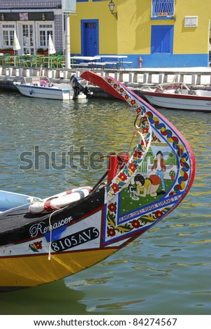 AVEIRO, PORTUGAL - AUGUST 8: Typical Moliceiro in Vouga river on August 08, 2011 in Averiro (Portugal). Moliceiro is this boat is a traditional Portuguese boat. - stock photo