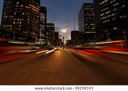 Avenida Paulista night traffic Sao Paulo Brazil - the avenue with the most expensive real estate in South America - stock photo
