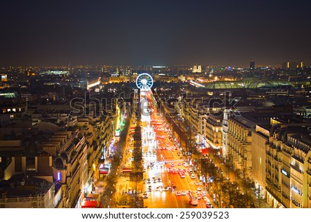 Avenue Champs-Elysees and ferris wheel  in Paris, France. View from Triumphal Arch - stock photo