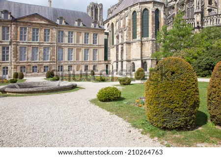 Avenue in a public garden near Palace of bishop and cathedral of Notre Dame in city Reims - stock photo
