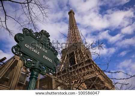 Avenue of gustave Eiffel underneath Eiffel Tower in Paris - stock photo