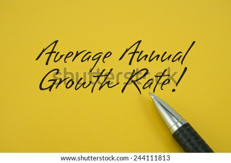 AverageAnnual Growth Rate! note with pen on yellow background - stock photo