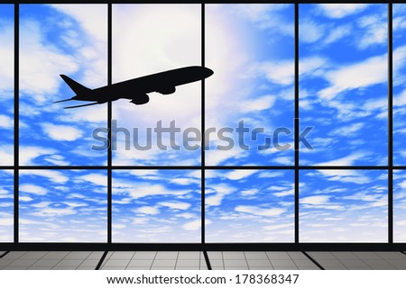 Aviation Concept. Airport windows with flying airplane  - stock photo