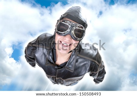 aviator flying in the blue sky - stock photo