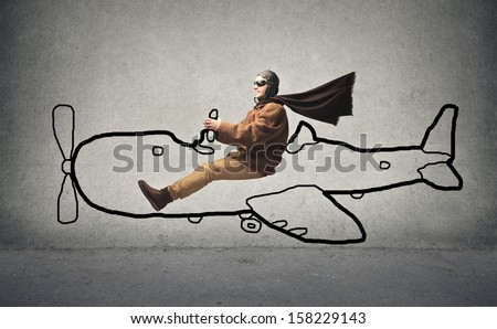 aviator flying with a designed airplane - stock photo